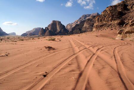 wadi: Tracks in sandy Wadi Rum desert, Jordan