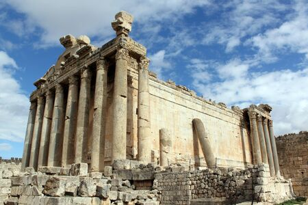 bacchus: Cloud, sky and Bacchus temple in Baalbeck, Lebanon Stock Photo