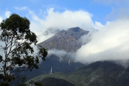 Clouds and top of mount Kinabalu in Sabah, Borneo, Malaysia photo