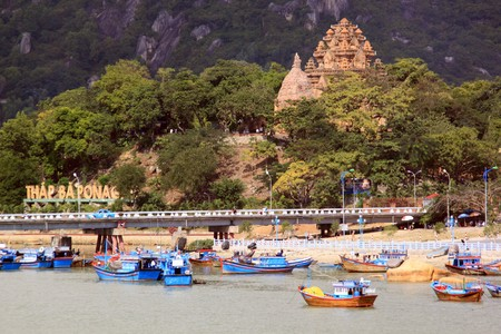 Old cham towers, bridge and boats in Nha Trang, Vietnam  photo