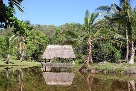 House and reflection on the lake in Fiji photo