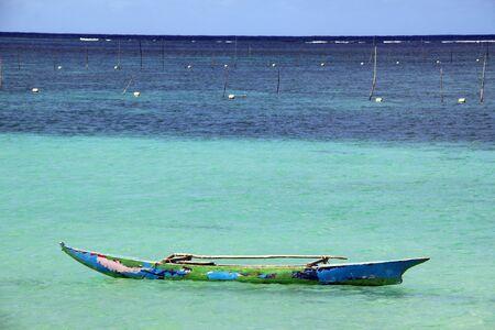 samoa: Wooden traditional boat on the water near Upolu island, Samoa Stock Photo