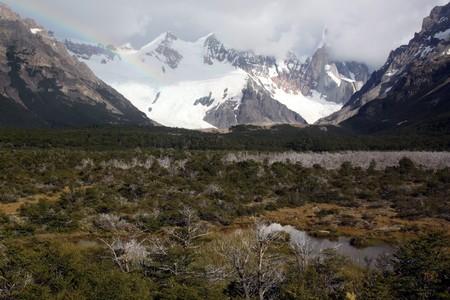 chalten: Rainbow and mountain area in national park, El Chalten, Argentina Stock Photo