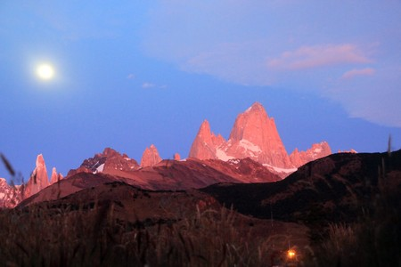 Red clifs of Fitz Roy and moon near El Chalten in Patagonia, Argentina photo