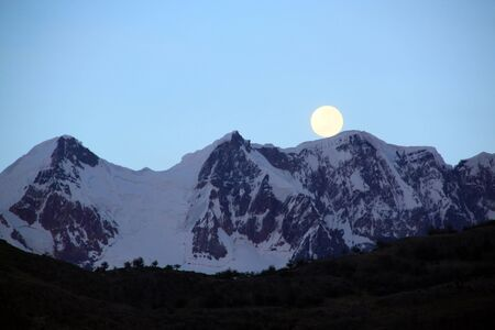 Mountain and fool moon mear El Chalten in Paragonia, Argentina photo