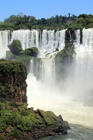 High Iguazu falls and river in Argentina photo