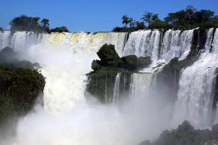 Mist and wide Iguazu waterfall in Argentina photo