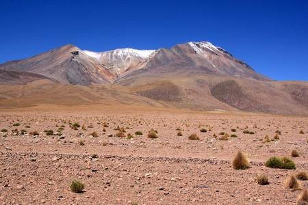 Stone desert and mountain near Uyuni in Bolivia photo