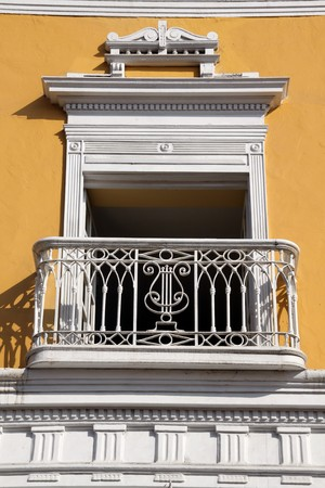 Yellow wall and white balcony of building in Trujillo, north Peru Stock Photo - 7770805
