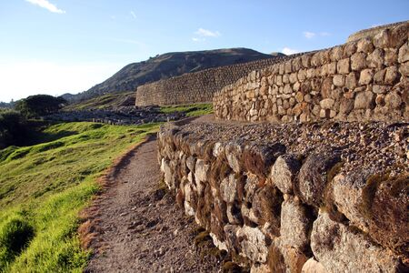 Footpath near the wall of fortress in Ingapirca in Ecuador