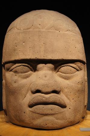 Big head of olmec warrior in museum Mexico                     photo