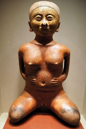 maya religion: Ceramic woman sculpture of precolombian art in Museum antropology in Mexico               Stock Photo