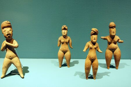 Male and female ceramics statues in museum in Puebla. Mexico                      photo