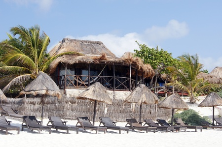 House and white sand Carribean beach in Tulum, Mexico              photo