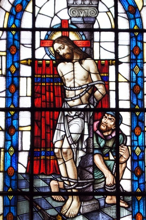 crist: Stained-glass window with Jesus Crist on the cross in Church
