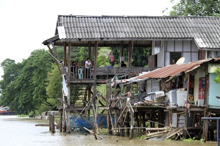 lake dwelling: Wooden houses on the river in Ayutthaya, Thailand Editorial