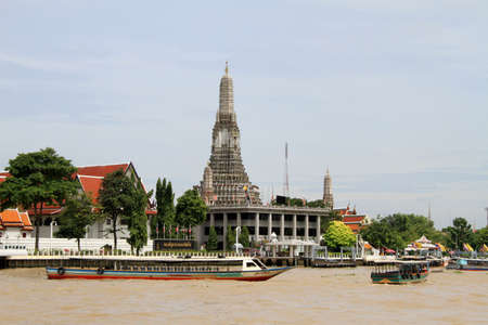 Long boats on the river near Wat Arun in Bangkok, Thailand