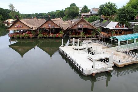floating bridge: Pier and floating restaurant near bridge on the river Kwai, Thailand Editorial
