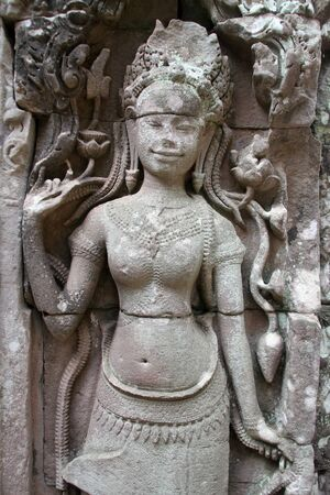 Stone apsara on the wall of temple Bayon, Angkor, Cambodia photo