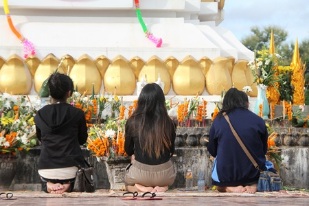 Women pray to Buddha in the shrine on the bank of Mekong, Vientiane, Laos