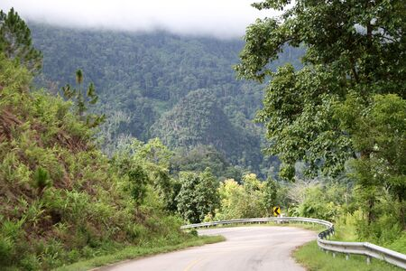 Curve on the road in mountain area, Northern Thailand photo