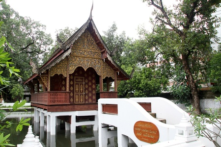 respectful: Bridge and small wooden temple on the pond in Wat Chiang Man, Chiang Mai, Thailand