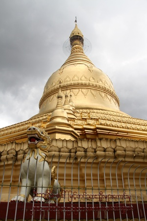 Lion and golden stupa in Ne Vin pagoda, Yangon, Myanmar photo
