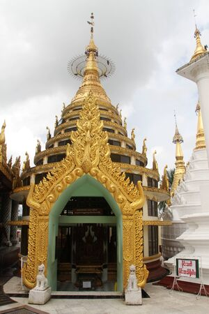 Temples on the way to Shwe Dagon pagoda in Yangon, Myanmar Stock Photo - 11208991