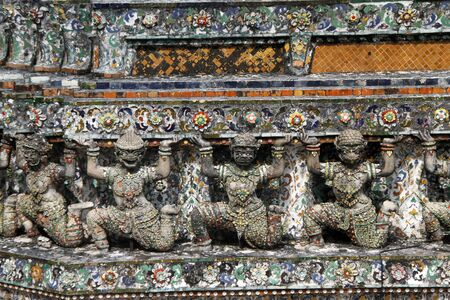 Statues on the prang of wat Arun in Bangkok, Thailand photo
