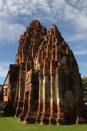 Ruins of red brick chedi Prang Khaek in Lop Buri, Thailand photo
