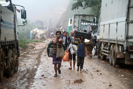 landslip: Group of the people on the road after landslip, Laos