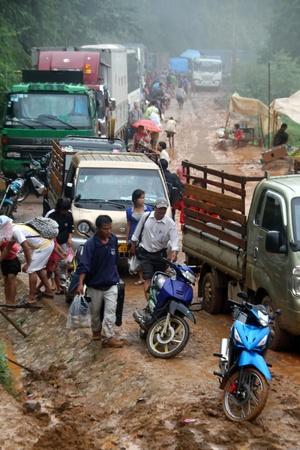 landslip: People on the road after landslip in wet season, Laos