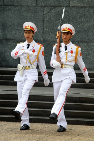 Slodiers in white uniform near Ho Chi Minh mausoleum in Hanoi, Vietnam