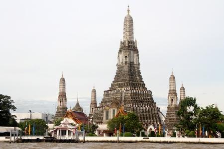 Wat Arun and bank of river Chao Phraya in Bangkok, Thailand