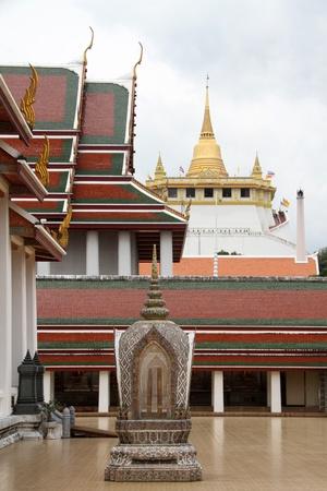 respectful: Stone sema and temple in Wat Saket Ratcha Wora Maha Wihan, Bangkok, Thailand Stock Photo