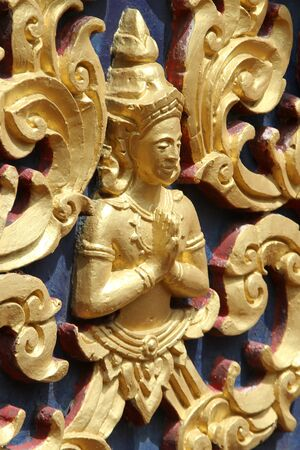 blissfull: Golden Buddha on the wall of temple in wat Hualampong, Bangkok, Thailand Stock Photo