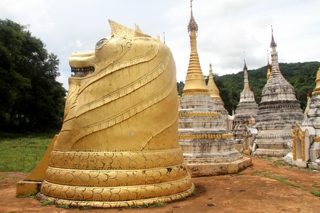 Golden stupas nesr basement of Pindaya natural caves in Myanmar photo