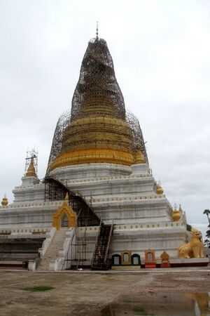 restoration of golden stupa in Inwa, Mandalay, Myanmar photo