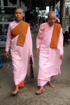 nuns: Buddhist nuns on the street in Yangon, Myanmar Editorial