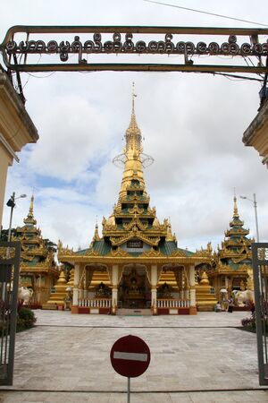 Golden stupa with temple in Yangon, Myanmar photo