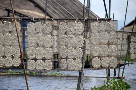 inle: Rice noodles on the net near hut on the Inle lake, Myanmar Stock Photo