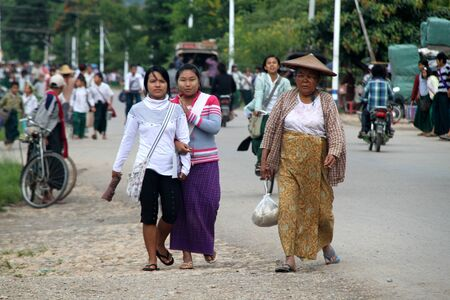 old school bike: Boys and girls on the way from school back to homes in Myanmar Editorial
