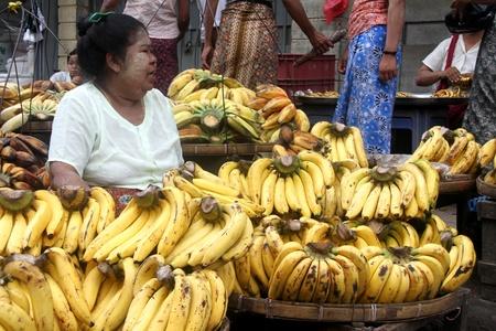 Woman with yellow bananas in the street market, Yangon, Myanmar Stock Photo - 11327995