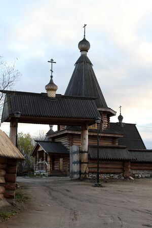 New wooden monastery buildings in Murmansk, Russia photo