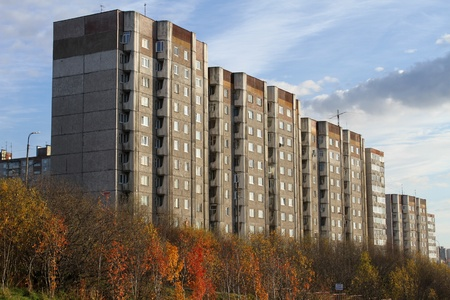 Apartment buldings and trees in autumn Murmansk, Russia