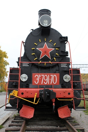 Black locomotive on the railway station in Medvezshyegorsk, Karelia, Russia