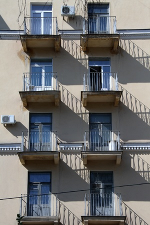 utilitarian: Balconies and windows on the wall of old building in Volgograd, Russia