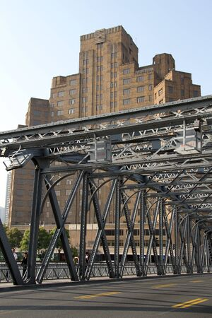 Old building and iron bridge in Shanghai, China photo