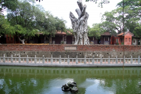 Fountain and facade of Confucius temple in Tainan, Taiwan photo