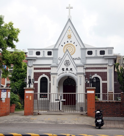 White catholick church on the street of Tainan, Taiwan Stock Photo - 13893816